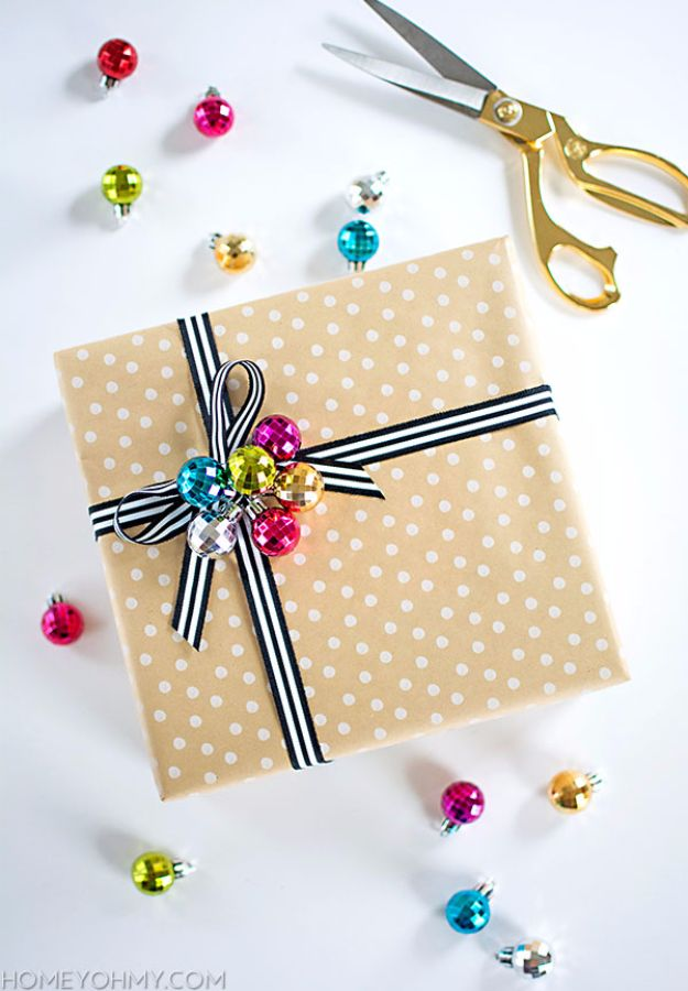 Creative Bows For Packages - Ribbon Bow With Ornament - Make DIY Bows for Christmas Presents and Holiday Gifts - Cute and Easy Ideas for Making Your Own Bows and Ribbons - Step by Step Tutorials and Instructions for Tying A Bow - Cheap and Crafty Gift Wrapping Ideas on A Budget http://diyjoy.com/diy-bows-gifts-packages