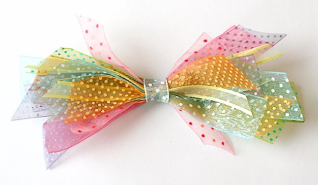 Creative Bows For Packages - Ribbon Scraps Bow - Make DIY Bows for Christmas Presents and Holiday Gifts - Cute and Easy Ideas for Making Your Own Bows and Ribbons - Step by Step Tutorials and Instructions for Tying A Bow - Cheap and Crafty Gift Wrapping Ideas on A Budget http://diyjoy.com/diy-bows-gifts-packages
