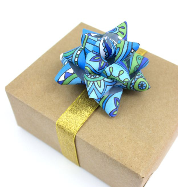 Creative Bows For Packages - Turn Coloring Pages Into Gift Bows - Make DIY Bows for Christmas Presents and Holiday Gifts - Cute and Easy Ideas for Making Your Own Bows and Ribbons - Step by Step Tutorials and Instructions for Tying A Bow - Cheap and Crafty Gift Wrapping Ideas on A Budget http://diyjoy.com/diy-bows-gifts-packages