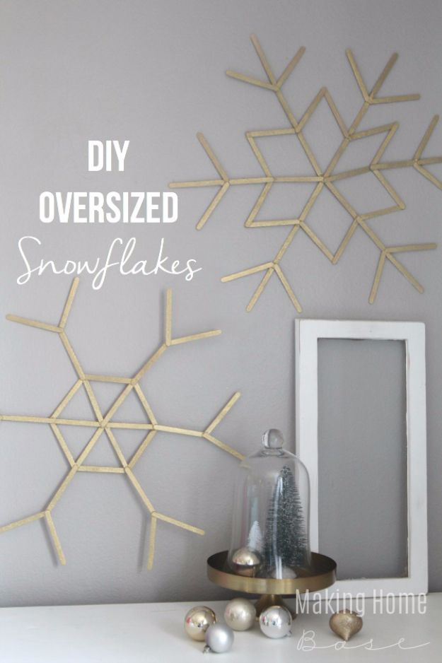 Cheap DIY Christmas Decor Ideas and Holiday Decorating On A Budget - DIY Oversized Snowflakes - Easy and Quick Decorating Ideas for The Holidays - Cool Dollar Store Crafts for Xmas Decorating On A Budget - wreaths, ornaments, bows, mantel decor, front door, tree and table centerpieces #christmas #diy #crafts