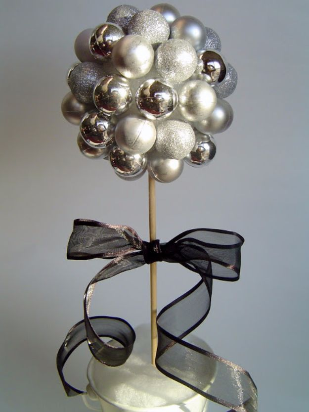 New Years Eve Decor Ideas - New Years Topiary - DIY New Year's Eve Decorations - Cheap Ideas for Banners, Balloons, Party Tables, Centerpieces and Festive Streamers and Lights - Cool Placecards, Photo Backdrops, Party Hats, Party Horns and Champagne Glasses - Cute Invitations, Games and Free Printables http://diyjoy.com/new-years-eve-decor-ideas