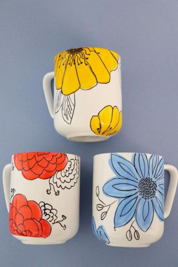 DIY Coffee Mugs - Customize Coffee Mugs With Hand-Drawn Flowers - Easy Coffee Mug Ideas for Homemade Gifts and Crafts - Decorate Your Coffee Cups and Tumblers With These Cool Art Ideas - Glitter, Paint, Sharpie Craft, Nail Polish Water Marble and Teen Projects http://diyjoy.com/diy-coffee-mugs
