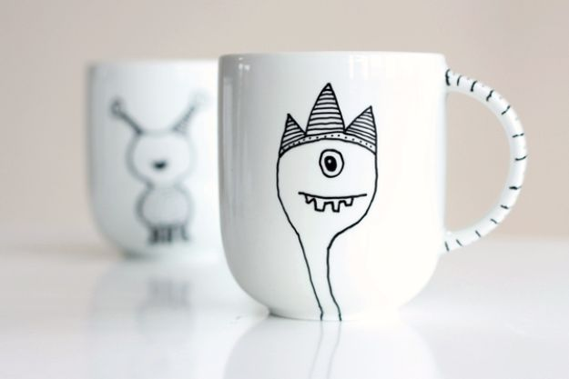 DIY Coffee Mugs - Decorate a Coffee Mug Using a Porcelain Marker - Easy Coffee Mug Ideas for Homemade Gifts and Crafts - Decorate Your Coffee Cups and Tumblers With These Cool Art Ideas - Glitter, Paint, Sharpie Craft, Nail Polish Water Marble and Teen Projects http://diyjoy.com/diy-coffee-mugs
