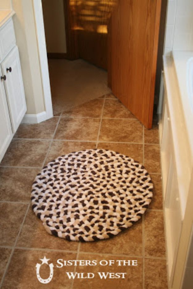 DIY Rugs - Braided Rug From Old Towels - Ideas for An Easy Handmade Rug for Living Room, Bedroom, Kitchen Mat and Cheap Area Rugs You Can Make - Stencil Art Tutorial, Painting Tips, Fabric, Yarn, Old Denim Jeans, Rope, Tshirt, Pom Pom, Fur, Crochet, Woven and Outdoor Projects - Large and Small Carpet http://diyjoy.com/diy-rug-tutorials
