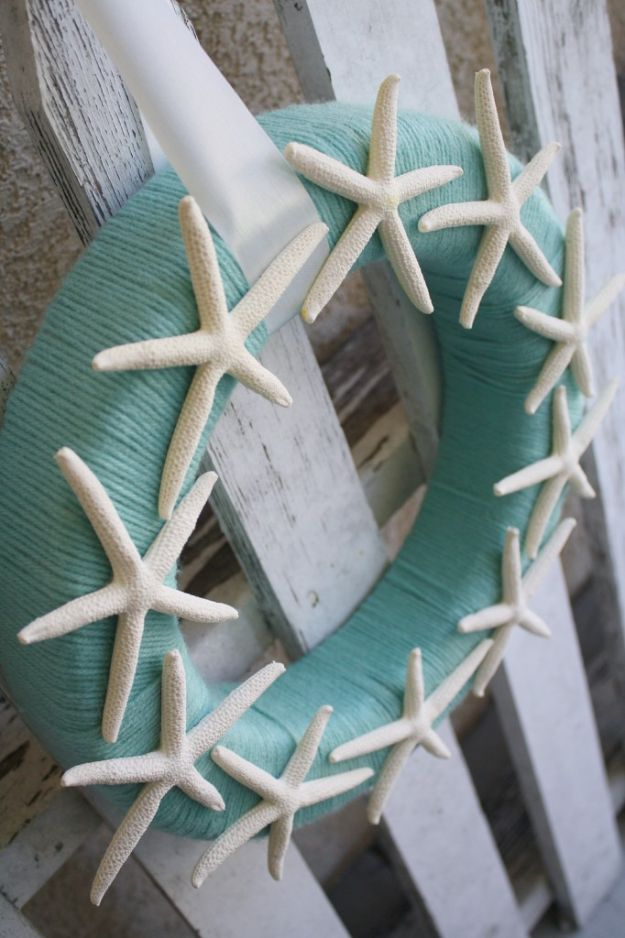 DIY Beach House Decor - Starfish Yarn Wreath - Cool DIY Decor Ideas While On A Budget - Cool Ideas for Decorating Your Beach Home With Shells, Sand and Summer Wall Art - Crafts and Do It Yourself Projects With A Breezy, Blue, Summery Feel - White Decor and Shiplap, Birchwood Boats, Beachy Sea Glass Art Projects for Living Room, Bedroom and Kitchen http://diyjoy.com/diy-beach-house-decor