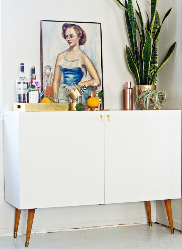 IKEA Hacks for Your Kitchen - Mid Century Bar Cabinet - DIY Furniture and Kitchen Accessories Made from IKEA - Kitchen Islands, Cabinets, Table, Pantry Organization, Storage, Shelves and Counter Solutions - Bar, Buffet and Entertaining Ideas - Easy Projects With Step by Step Tutorials and Instructions to Hack IKEA items http://diyjoy.com/ikea-hacks-kitchen #ikeahacks #diyhomedecor #diyideas #diykitchen