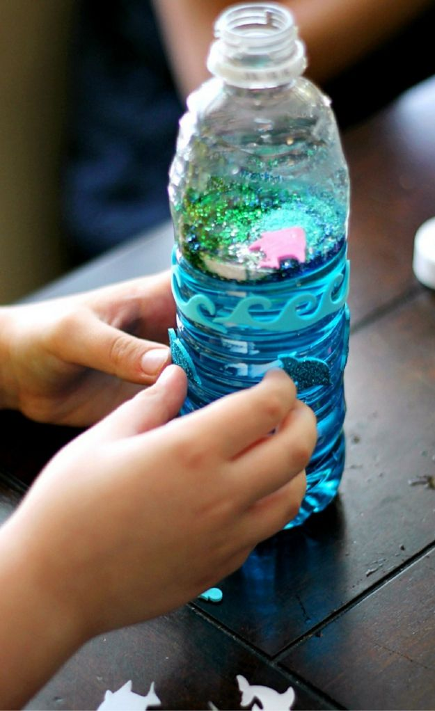 Easy Crafts for Kids - Ocean Glitter Bottles - Quick DIY Ideas for Children - Boys and Girls Love These Cool Craft Projects - Indoor and Outdoor Fun at Home - Cheap Playtime Activities https://diyjoy.com/best-easy-crafts-for-kids