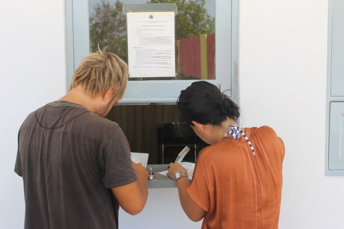Filling out application at East Timor Consulate