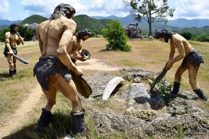 Cavemen burying one of their own