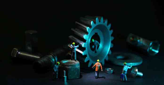 Image representing imaginary workers performing maintenance on a computer.