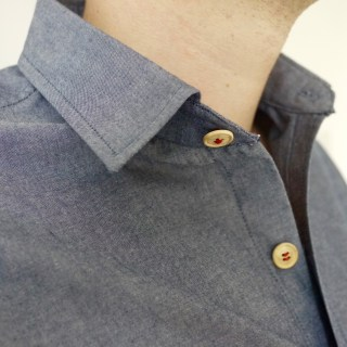 The red button thread subtly brightens up the front placket.