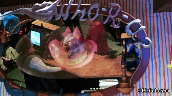 Chesire Cat smiling in magic mirror in Mad Hatter store Disneyland California Fantasyland
