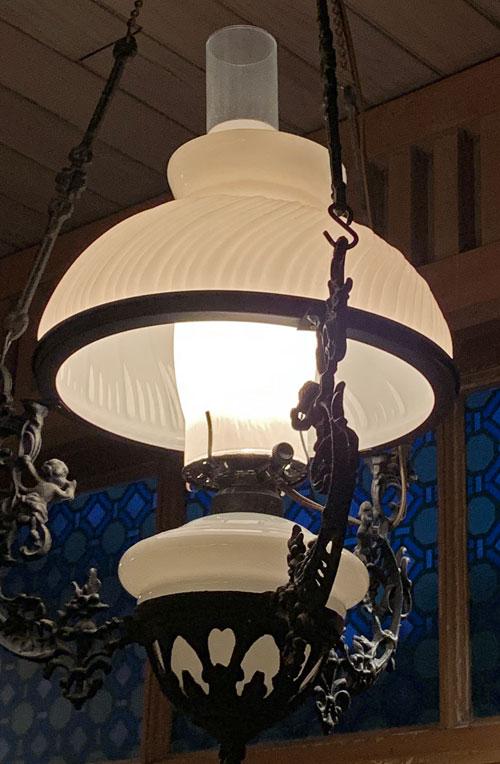 Old West light fixture hanging in Crockett and Russel Hat Co in Disneyland Frontierland