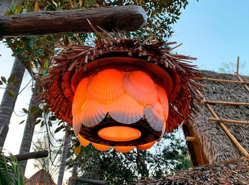 Shell and straw tropical light fixture at Enchanted Tiki Room Disneyland