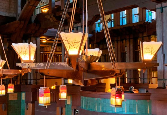 Enormous light fixture hanging from ceiling of The Grand Californian Hotel lobby in Anaheim California Disneyland