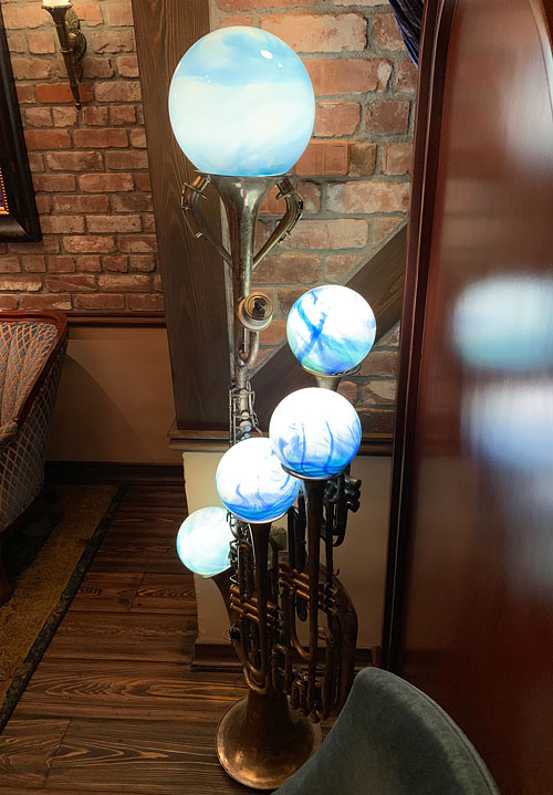 Creative musical instrument light fixture in Disneyland Club 33 New Orleans Square