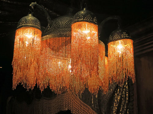 Dramatic hanging light fixture in Pieces of Eight Shop Disneyland