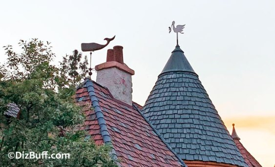 Stork and whale roof ornaments or spires on roof of Pinocchio's Daring Journey in Disneyland Fantasyland