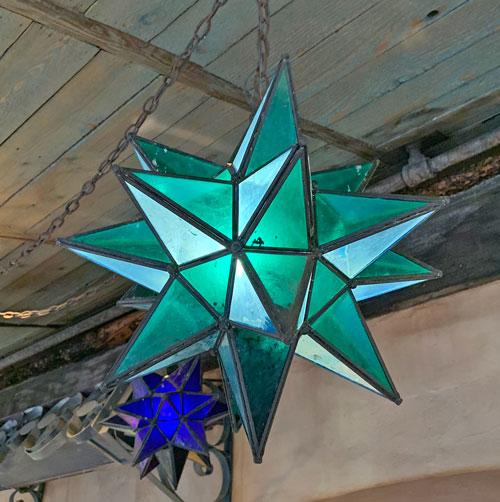 Green star shaped light fixture at Rancho del Zocalo Restaurant in Disneyland Frontierland
