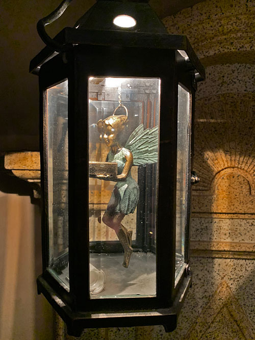 Tinker Bell light fixture in Court of Angels at Disneyland Club 33 New Orleans Square