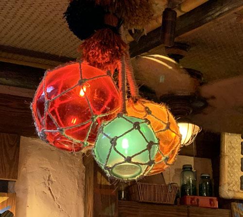 Multicolored glass globe rope net ceiling lamp or light fixture at The Tropical Hideaway Restaurant in Adventureland Disneyland