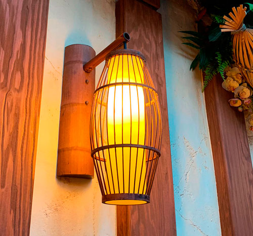 Wall mounted wooden light fixture at The Tropical Hideaway Restaurant in Adventureland Disneyland