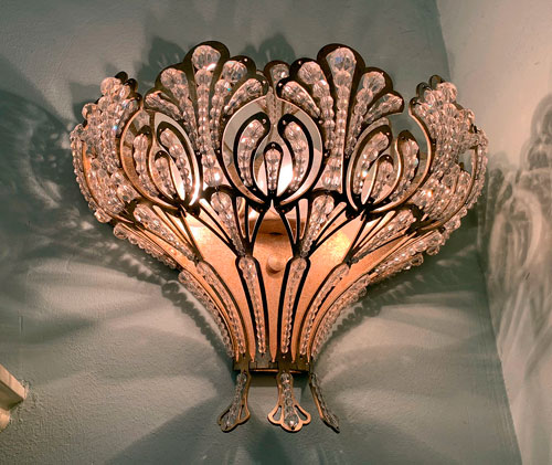 Glass beaded wall sconce light fixture in Disneyland Club 33
