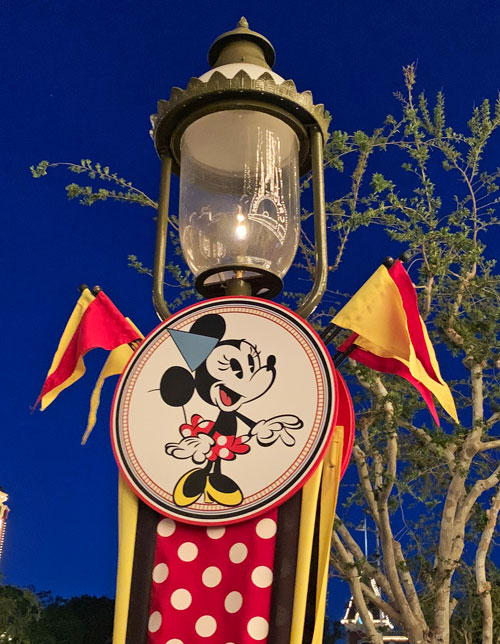 Gas lamp on Main Street USA with picture of Minnie Mouse in Disneyland