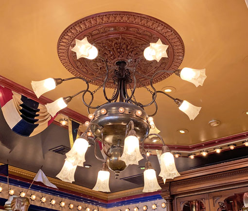 Ceiling light fixture with medallion in Penny Arcade on Main Street USA in Disneyland CA