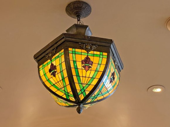 Arts and Crafts or Tiffany style Light fixture in Penny Arcade in Disneyland on Main Street USA