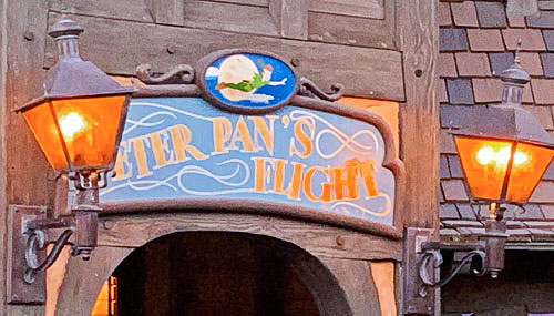 Twin light fixtures on sign for Peter Pan's Flight attraction at Disneyland in Fantasyland