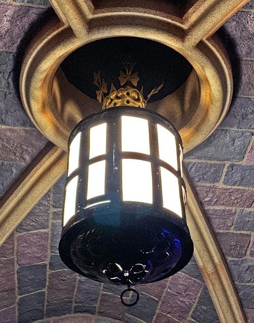 Light fixture hanging from Sleeping Beauty Castle in Disneyland California