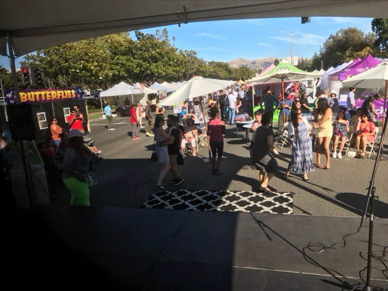 Crowd Dancing as DJ Alex Reyes performs at the Fremont Festival of Arts