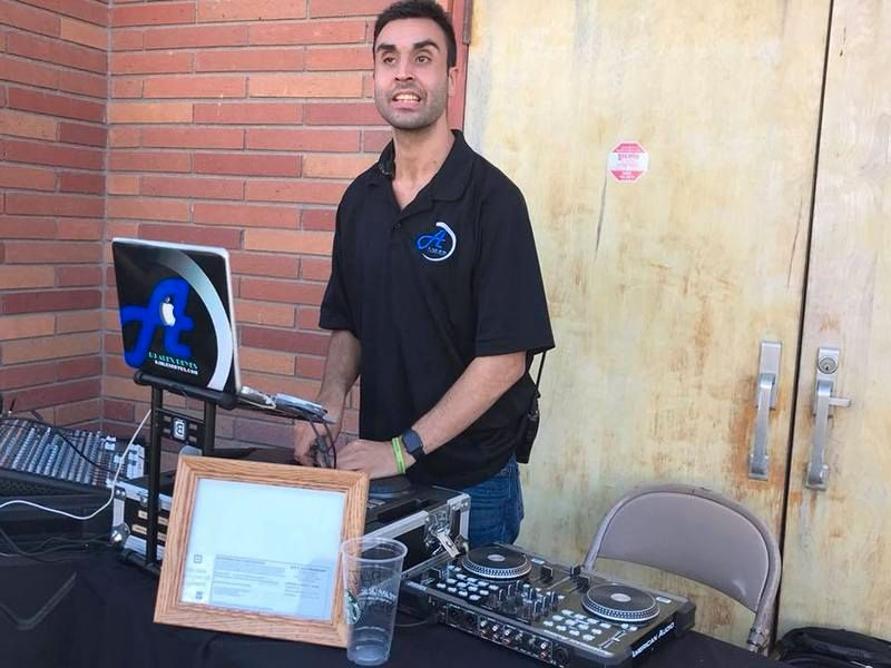 DJ Alex Reyes performing at a Dog Show