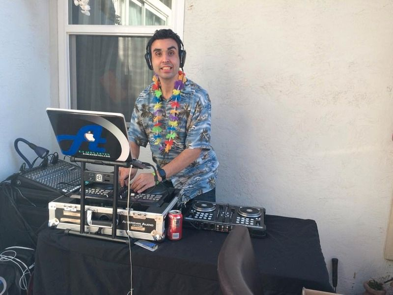 DJ Alex Reyes performing at a Family Party