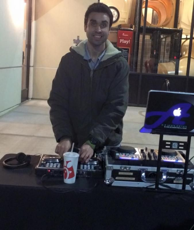 DJ Alex Reyes performing at a Grand Opening