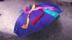 a dance umbrella. both the use of color and the streamers reflect an 'amis aesthetics