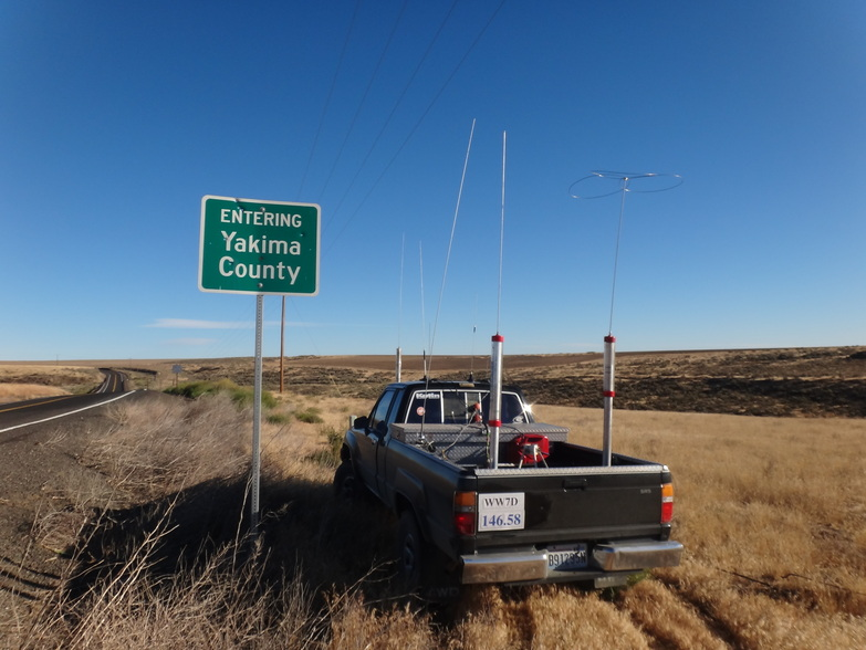 Image of rover parked next to the Yakima/Klikitat county line sign.