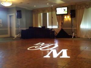 Monogram on Dance-floor & Plasma Screen next to DJ Johnny Only's table.