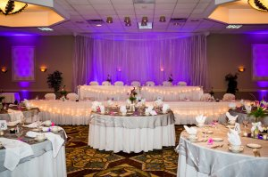 Uplighting behind the head table transforms nice into gorgeous!