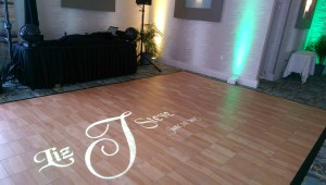 Wedding Couple's projected monogram on the dancefloor