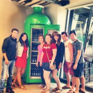 Group shot in front of a fridge of beer! Photo Credit: Emily