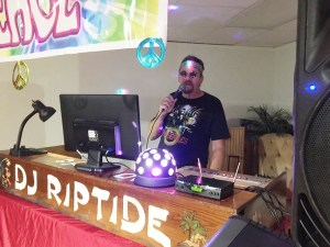 Dave at the DJ Table doing a 60's party