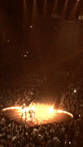 """Madonna plays acoustic guitar during her performance of """"Ghosttown"""" at Chicago's United Center."""
