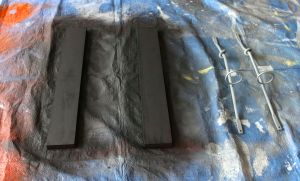 Flat black spray paint on the wood and flat grey primer on the holders.