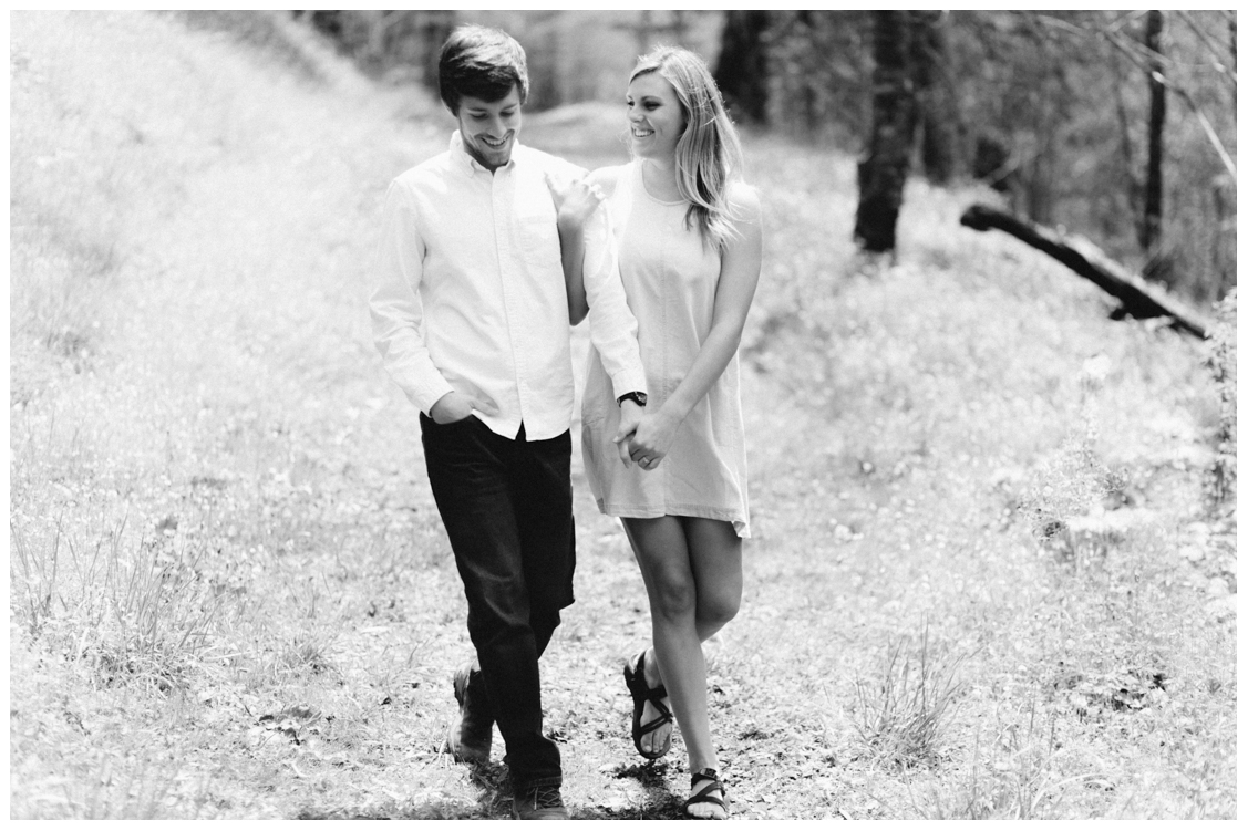 bride-and-groom-laughing-and-walking-charlies-bunion-engagement-Jill and Daniel