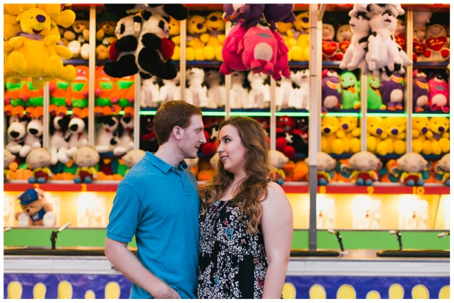 googly eyes in front of the prizes - Carnival Engagement - Courtney and Alan
