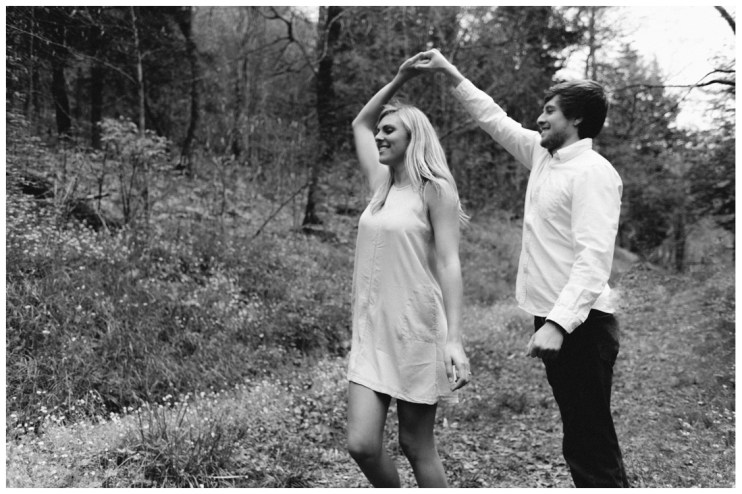 groom-spins-bride-while-dancing-smokey-mountains-charlies-bunion-engagement-Jill and Daniel
