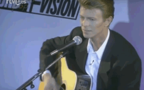 David Bowie plays acoustic guitar at the Sound & Vision tour press conference in 1990