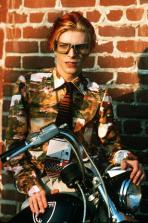 David Bowie poses on a motorcycle